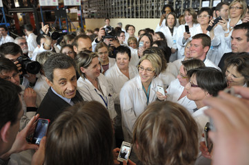 France's President and UMP party candidate for the 2012 French presidential elections Sarkozy visits Safran Sagem defence security circuit boards plant in Fougeres