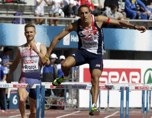 Woodward clears a hurdle ahead of Prorok during the men's 400 metres hurdles heats at the European Athletics Championships in Helsinki