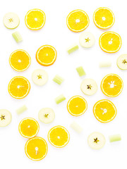 Fresh fruit in a cut on a white background. Pattern of citrus fruits. Food background.