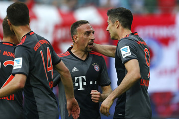 Bayern Munich's Robert Lewandowski celebrates scoring their first goal with Franck Ribery