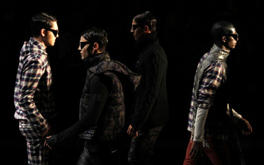 Models present creations from Reserva's Fall/Winter 2010/11 collection during the Sao Paulo Fashion Week
