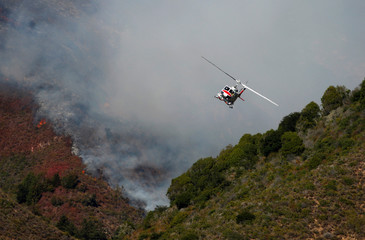 A Cal Fire helicopter flies over Garrapata State Park during the Soberanes Fire north of Big Sur