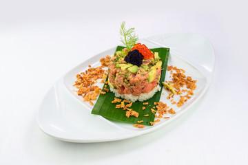 Smoked salmon tartare with avocado, rice and caviar