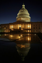 The U.S. Capitol Building is lit at sunset in Washington