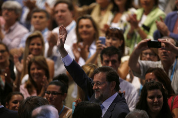 Spain's opposition Popular Party leader Rajoy waves after speaking at his Popular Party's national convention