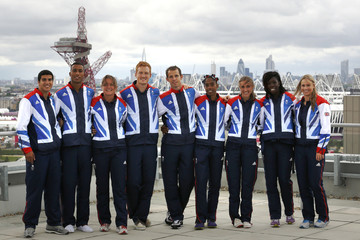 Athletes selected for the  Team GB track and field events pose ahead of a news conference at the Team GB House in London