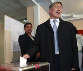 Kyrgyzstan's Prime Minister and presidential candidate Atambayev casts his ballot during the presidential election at a polling station in the capital Bishkek