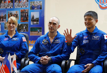 Crew members attend news conference before their launch to ISS at Baikonur cosmodrome