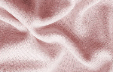 surface of a soft knitted fabric made of cashmere with large folds, a detail of clothes