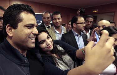 Presidential candidate Slim Riahi poses for a photo in Tunis