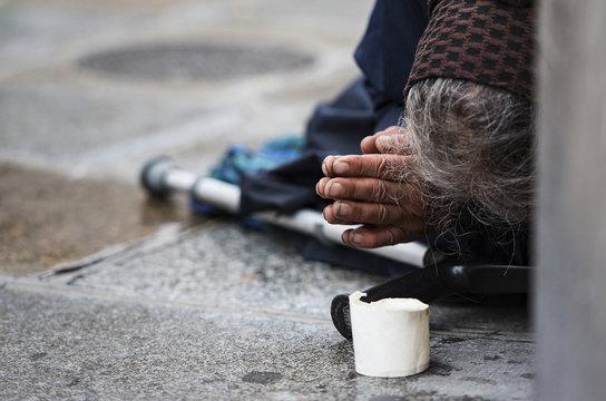 Homeless elderly woman refugee  in a street