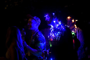 Revellers are lit up as night falls during the Glastonbury Festival