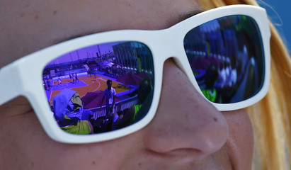 The court is reflected in sunglasses during a women's group stage 3x3 basketball match at the 1st European Games in Baku
