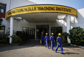 Students walk to an outdoor classroom at the Larsen & Toubro construction skills training institute in Panvel