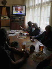 Local customers of a small pub in the village of Oubenice near Benesov watch the live TV broadcast of Czech Republic's Health Minister Heger's news conference