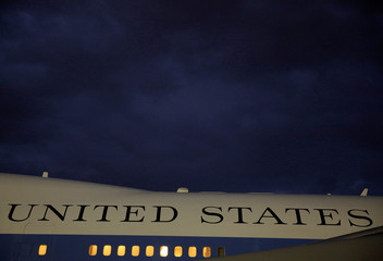 Air Force One is parked under cloudy skies at Andrews Air Force Base, Maryland