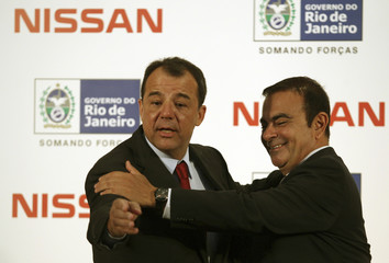 Renault-Nissan Motor Co Ltd Chief Executive Ghosn and Rio's governor Cabral joke  in Rio de Janeiro