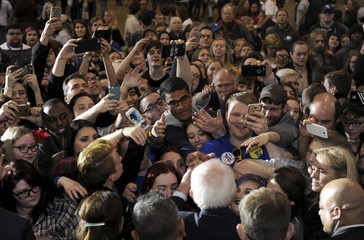 Supporters reach for U.S. Democratic presidential candidate Sanders after a campaign event in Lawrence