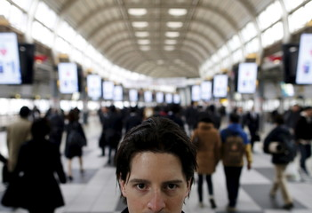 Burke, who shared a cell block with Niculas Fernando, poses for pictures at a station near Tokyo Regional Immigration  Bureau which includes a Tokyo detention center in Tokyo