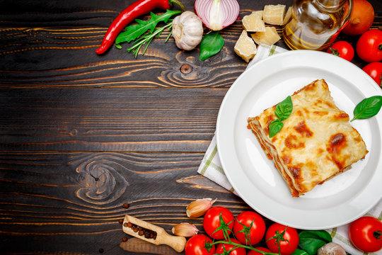 frame - tasty lasagna on wooden backgound