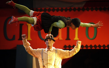 Italian team Baccala perform during a circus show at Al Azhar Park in Cairo