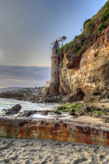 Sunset over Pirates tower at Victoria Beach in Laguna Beach