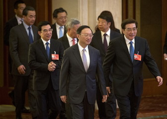 Chinese government officials arrive for the opening ceremony of the Asian Infrastructure Investment Bank (AIIB) in Beijing