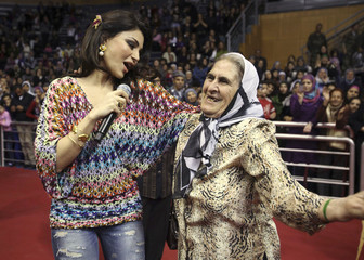Pop star Wehbe sings as she dances with a woman during a concert on Mother's Day in Beirut