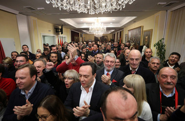 Supporters of the ruling Macedonian party VMRO-DPMNE celebrate during parliamentary elections in the party headquarters in Skopje