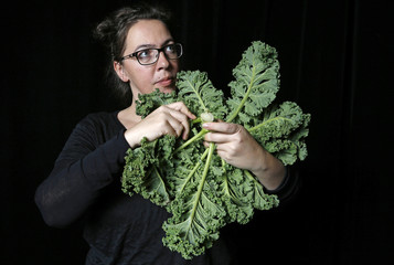 Austrian musician Barbara Kaiser poses for a picture with a musical instrument made from vegetables in Haguenau, eastern France