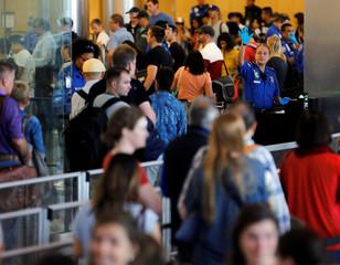 Travelers make their way through TSA security at Lindbergh Field airport in San Diego
