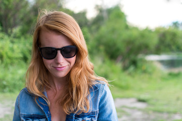 Red haired girl with sunglasses