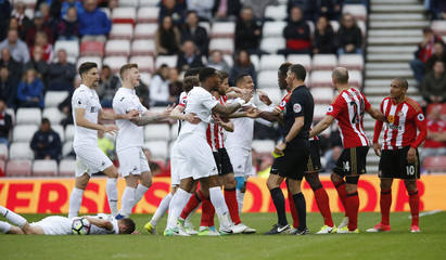 Players from both teams clash after Sunderland's Wahbi Khazri fouls Swansea City's Gylfi Sigurdsson