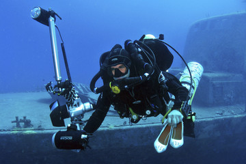 Israeli photographer Felten dives to a location of an underwater photo shoot in the Red Sea in Eilat