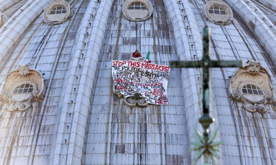 Italian businessman Di Finizio displays a banner to protest against austerity measures, on the dome of St. Peter's Basilica at the Vatican