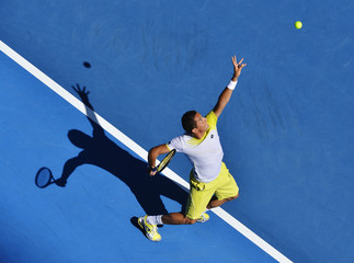 Nicolas Almagro of Spain serves to Janko Tipsarevic of Serbia during their men's singles match at the Australian Open tennis tournament in Melbourne