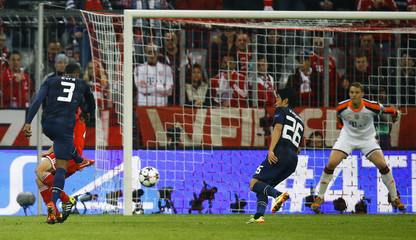 Manchester United's Evra scores a goal against Bayern Munich's Neuer watched by Kagawa during their Champions League quarter-final second leg soccer match in Munich