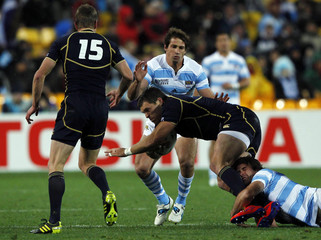 Argentina's Marcelo Bosch tackles Scotland's Sean Lamont during their Rugby World Cup Pool B match at Wellington Regional Stadium in Wellington