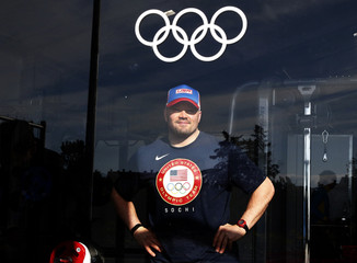 U.S. bobsled pilot Steve Holcomb poses for a picture at the fitness center in the Coastal Cluster Olympic Village in Sochi