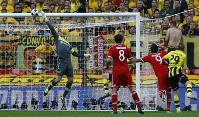 Borussia Dortmund's goalkeeper Zlatan Alomerovic saves a shot by Bayern Munich's Mario Mandzukic during their Champions League Final soccer match at Wembley Stadium in London