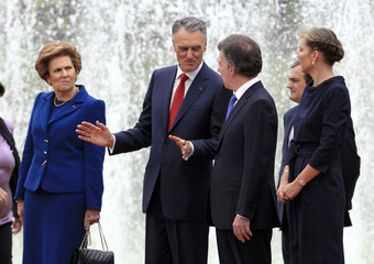 Portugal's President Anibal Cavaco Silva speaks with his Colombian counterpart Juan Manuel Santos during an official ceremony at the presidential palace in Bogota