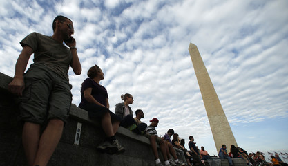 People, who are first in line, await for tickets to the re-opened Washington Monument in Washington