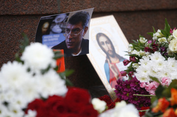 A photo, an icon and flowers are placed at the site where Boris Nemtsov was shot dead, near the Kremlin in central Moscow