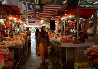 A woman shops in a wet market in Kuala Lumpur