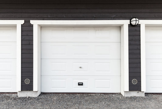 White garage wall with white closed gates