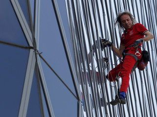 French climber Alain Robert, a rock climber who has become famous for climbing known buildings worldwide, climbs the 215m (705 feet) high, 50 floors Bakrie Tower building in Jakarta