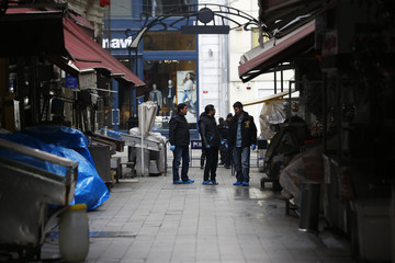 Police secure the area following a suicide bombing in central Istanbul