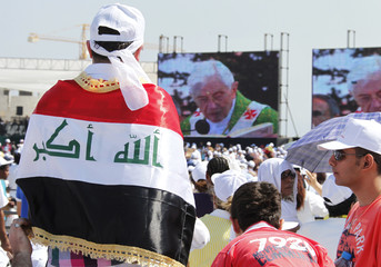 A faithful wearing an Iraqi flag attends an open air mass service conducted by Pope Benedict XVI at Beirut City Centre Waterfront