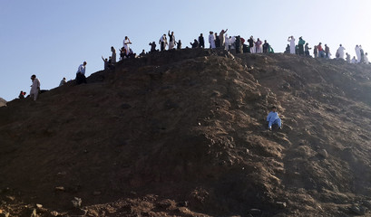 Muslims climb and pray on Mount Uhud, north of Medina, during the week of Eid Mawlid al-Nabawi