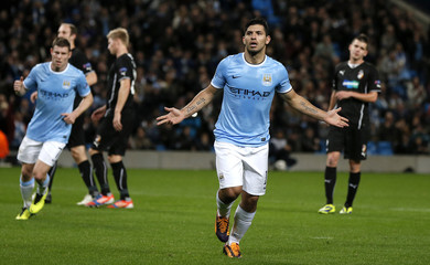 Manchester City's Sergio Aguero (2nd R) celebrates after scoring during their Champions League soccer match against Viktoria Plzen in Manchester